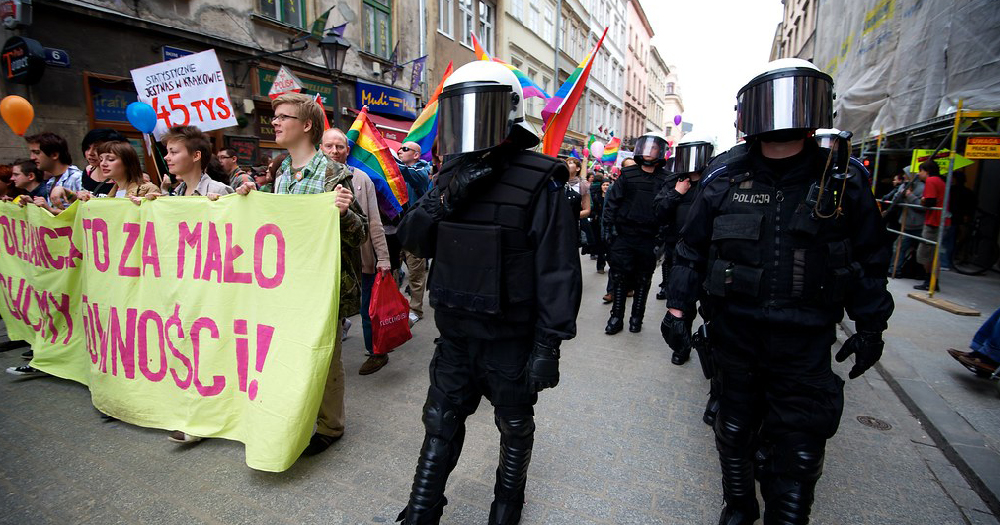 A Pride march passing by armed police