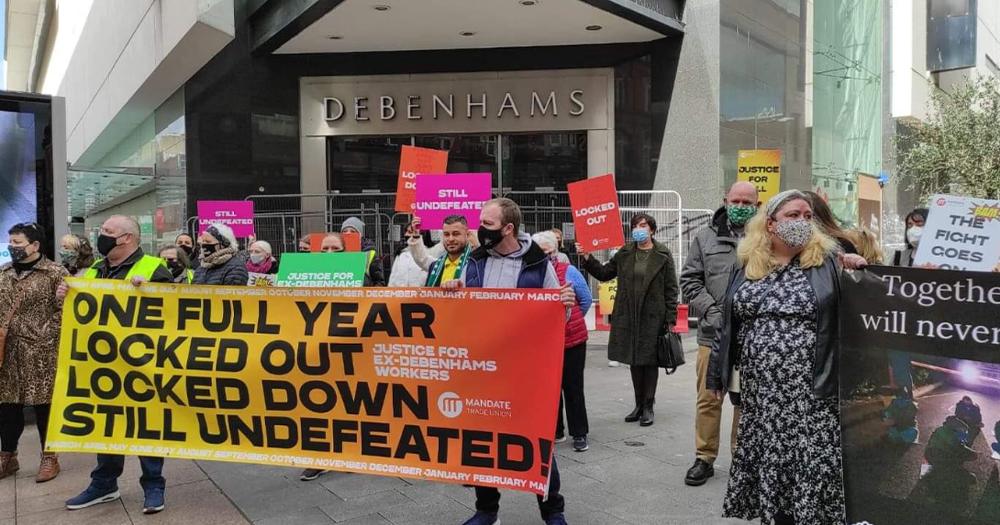 People protesting outside a Debenhams store