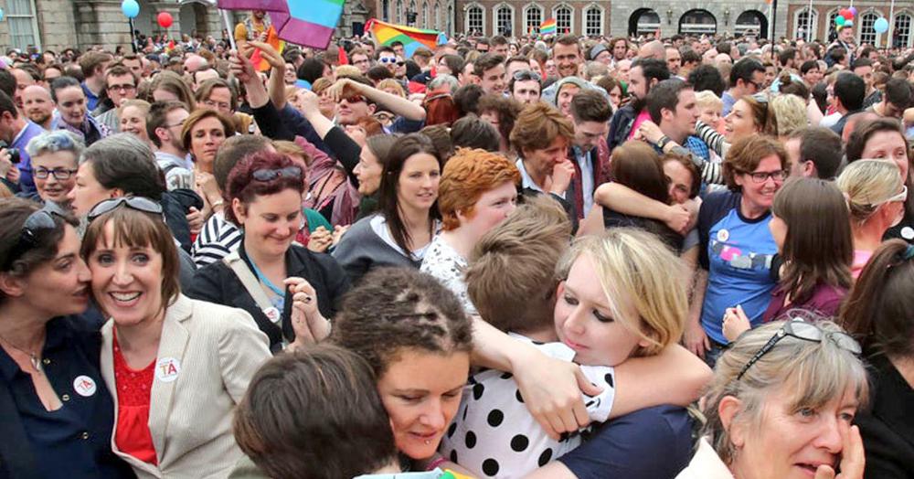 Crowds of people hugging