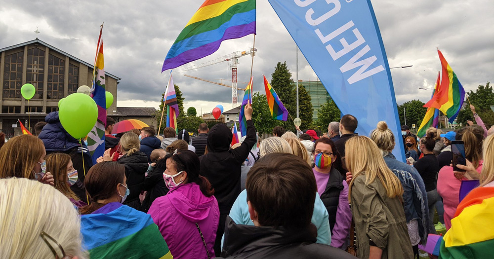 A group of people holding rainbow banners