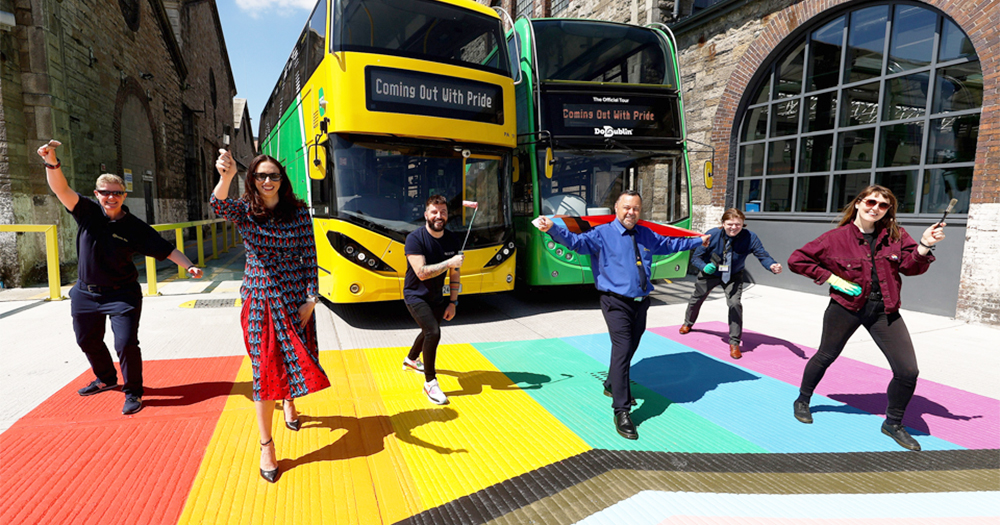 Dublin Bus & GCN press shot: members of Dublin Bus and GCN team pose standing on a rainbow crossing