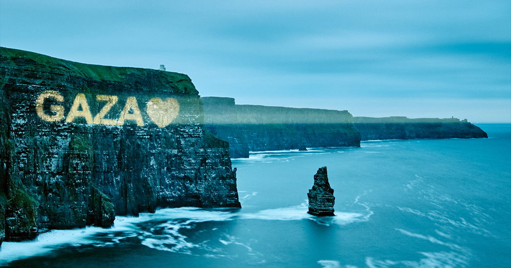 The word 'Gaza' projected onto the side of a sea cliff