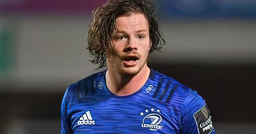 A long haired rugby player playing a match