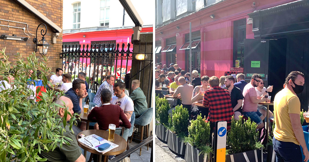 The exteriors of two bars with people gathered