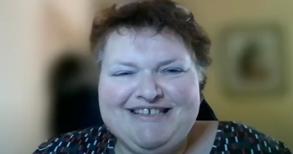 A smiling woman on a zoom call