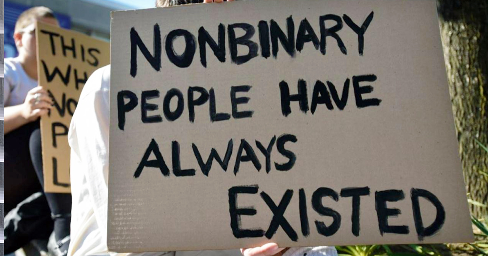 A sign reading 'non binary people have already existed'