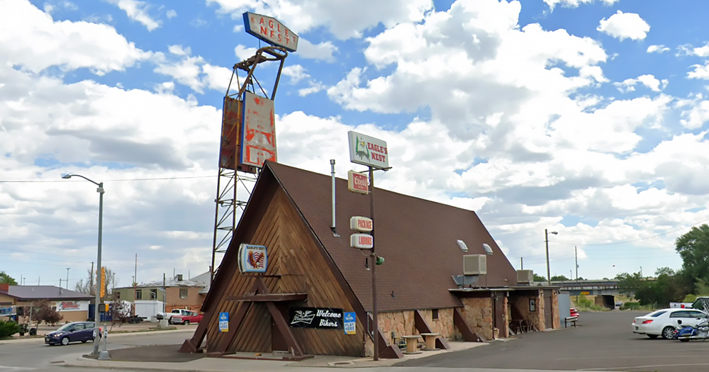 The Eagles Nest, a bar in Wyoming which under fire for selling homophobic t-shirts, is pictured in front of a cloudy blue sky