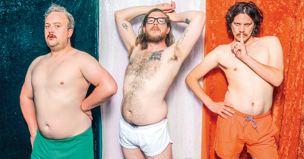 image of Young hot guyz calendar three men pose in their underwear in front of an Irish flag