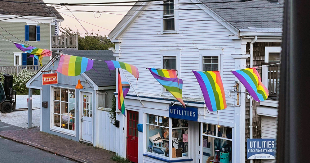 Postcard from Provincetown: a shop front with 'utilities' sign and rainbow banners