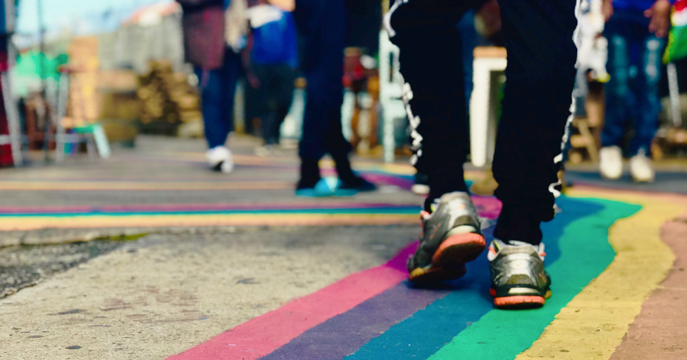 picture of a person walking on a rainbow pavement to illustrate Queer walking tour Ranelagh