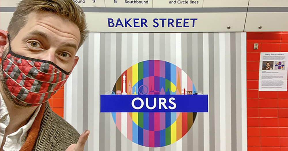 A picture of the Creator Tim Dunn in front of London Underground Pride roundels