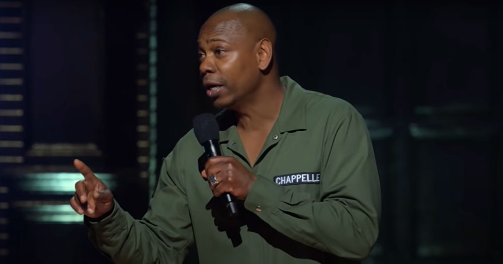 Dave Chappelle performing onstage in Netflix special