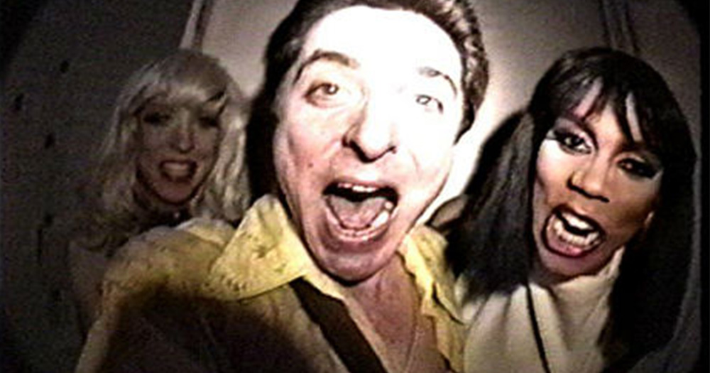 Vintage 1980s footage of a man and two drag queens happily shouting at a camera