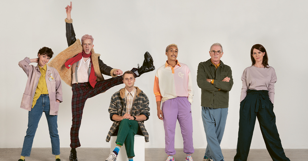A group of four men and two women wearing 1980s clothes all posing humorously against a blank background in a publicity shot for the play Once Before I Go