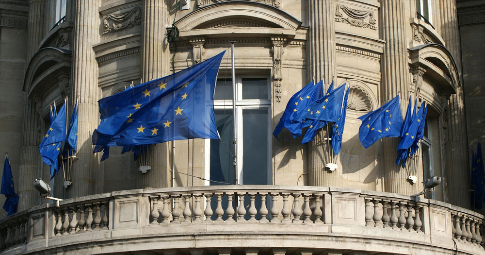 Grand political building with European Union flags