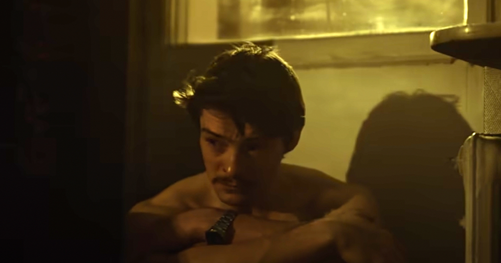 Screenshot from Polish gay thriller, Operation Hyacinth - Topless man with moustache in dark room
